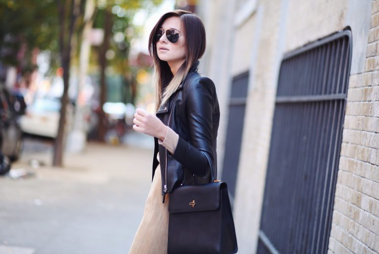 Leather jacket on a fine dress